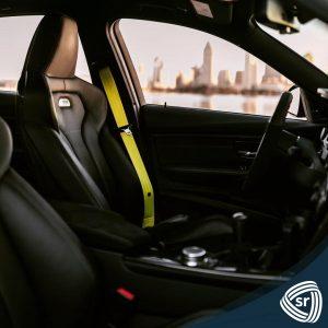 yellow seat belts inside of car