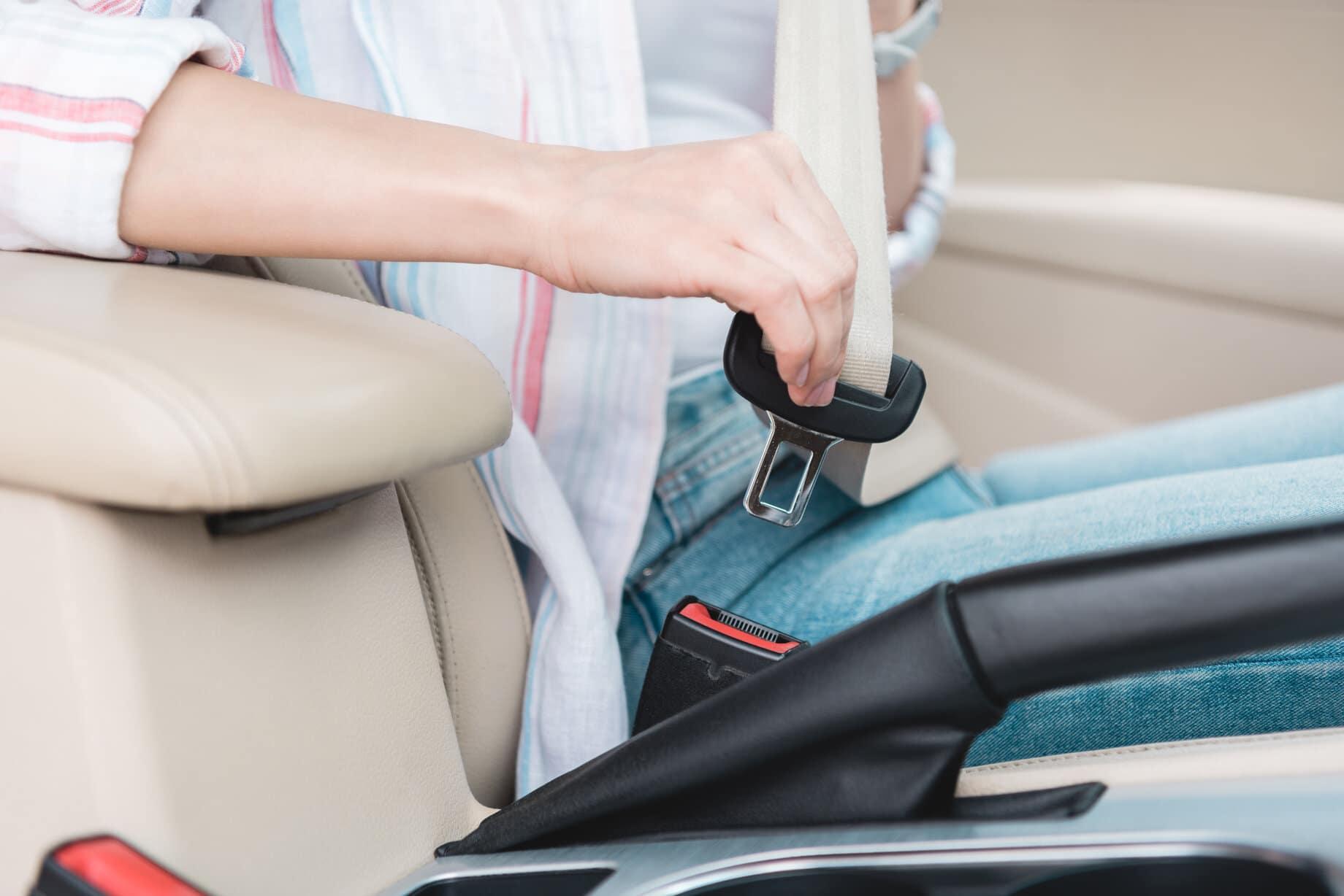 woman using a seat belt